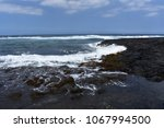 waves crashing on rocky shore... | Shutterstock . vector #1067994500