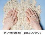 hands holding sand | Shutterstock . vector #1068004979