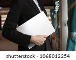 the girl holds the white... | Shutterstock . vector #1068012254