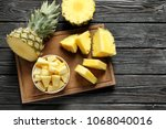 wooden board with fresh sliced... | Shutterstock . vector #1068040016