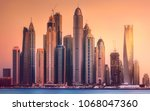 modern buildings with gold... | Shutterstock . vector #1068047360