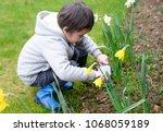 4 Years Old Boy Using Garden...
