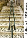 a narrow street with stairs in... | Shutterstock . vector #1068059696