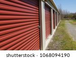 rows of self storage units with ... | Shutterstock . vector #1068094190