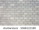 wall of cement blocks.... | Shutterstock . vector #1068122180