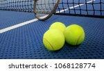 tennis balls on an indoor... | Shutterstock . vector #1068128774