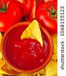 nachos with tomato sauce | Shutterstock . vector #1068155123