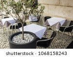 tables and chairs of restaurant ... | Shutterstock . vector #1068158243