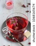pink peony hot tea with white... | Shutterstock . vector #1068165674
