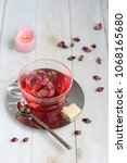 pink peony hot tea with white... | Shutterstock . vector #1068165680