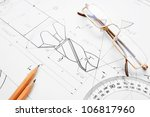 glasses  pencil on the drawing. | Shutterstock . vector #106817960