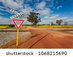 an australian country road with ... | Shutterstock . vector #1068215690