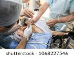 surgical procedure.... | Shutterstock . vector #1068227546