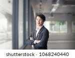 a smart and handsome business... | Shutterstock . vector #1068240440