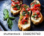 classic tomato basil bruschetta ... | Shutterstock . vector #1068250760
