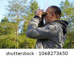 young ornithologist looking... | Shutterstock . vector #1068273650