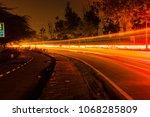 light trails of cityscape in... | Shutterstock . vector #1068285809