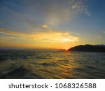 sunrise on kauai beach  sunrise ... | Shutterstock . vector #1068326588
