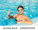 happy girl face shows thumbs up ... | Shutterstock . vector #1068342020