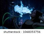 girl smoking hookah blue... | Shutterstock . vector #1068353756