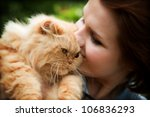 Stock photo young woman with persian cat playing outdoors portrait 106836293