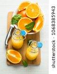 orange juice in bottles  knife... | Shutterstock . vector #1068385943