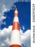 red white chimney of a large... | Shutterstock . vector #1068393029