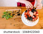 pastry chef at a wooden table... | Shutterstock . vector #1068422060