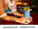 girl with decor and bracelets... | Shutterstock . vector #1068431033