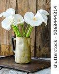 bouquet of white calla lily... | Shutterstock . vector #1068444314