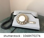 vintage old phone with dial disk | Shutterstock . vector #1068470276