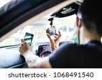close up technician hand with... | Shutterstock . vector #1068491540