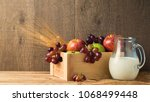 milk jug and box with fruits on ... | Shutterstock . vector #1068499448