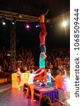 Small photo of Siem Reap, Cambodia - August 4th, 2016:A acrobatics troupe is performing their shows, and there are lots of people watching and enjoying the show.