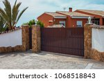 automatic gates for a country... | Shutterstock . vector #1068518843