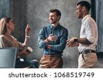 discussing project together.... | Shutterstock . vector #1068519749