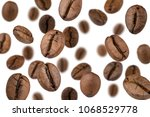 brown roasted coffee beans... | Shutterstock . vector #1068529778