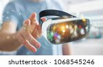 Stock photo businessman on blurred background using virtual reality glasses technology d rendering 1068545246