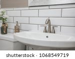 bathroom sink shot close up... | Shutterstock . vector #1068549719