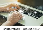 man working on laptop | Shutterstock . vector #1068554210