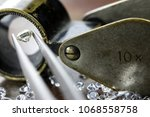 brilliant cut diamond held by... | Shutterstock . vector #1068558758