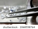brilliant cut diamond held by... | Shutterstock . vector #1068558764