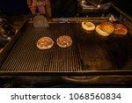 chef making pork burgers... | Shutterstock . vector #1068560834