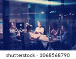 multiethnic startup business... | Shutterstock . vector #1068568790
