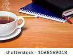 a cup of hot tea on the table... | Shutterstock . vector #1068569018