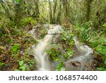 floodwater pouring through the...   Shutterstock . vector #1068574400