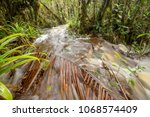 floodwater pouring through the...   Shutterstock . vector #1068574409