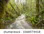 floodwater pouring through the... | Shutterstock . vector #1068574418