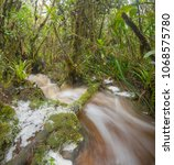 floodwater pouring through the...   Shutterstock . vector #1068575780