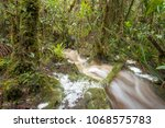 floodwater pouring through the...   Shutterstock . vector #1068575783
